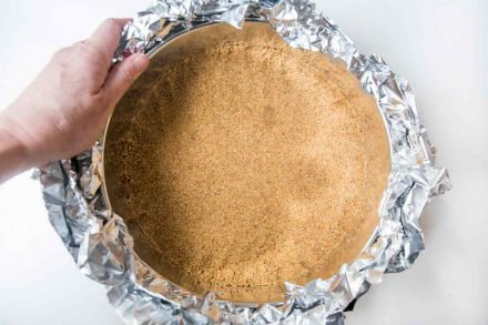 Wrapping foil around the graham cracker crust