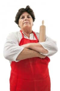 A Stern Grandmother Disapproving Of The Use Of Cake Mixes.
